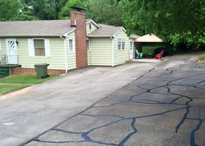 Cracked Asphalt Driveway